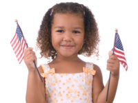 Girl holding American flags